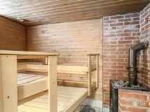 Ihanan rouhea sauna puu-, ja sähkökiukaalla