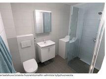 Havainnekuva kylpyhuoneesta remontoituna