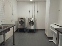 A-talon pyykinpesutila ovesta kuivaushuoneeseen