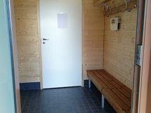 Taloyhtiön saunaosaston pukuhuone