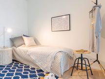 Valokuva esittelyasunnon  makuuhuoneesta