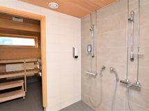 Yhtiön saunaosaston pesutila