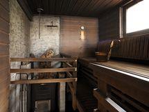 Rantarakennuksen puulämmitteinen sauna.