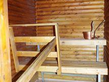 tilava sauna, jossa nykyisellään sähkökiuas