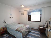 C-huoneiston makuuhuone