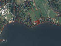 Maanmittauslaitoksen ilmakuvassa ja rajat Reunatie 49