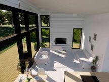 Paljon ikkunapintaa, joka laskee luonnonvaloa sisään (havainnekuva)