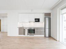 Keittiön kuva vastaavasta asunnosta B24. Kalusteiden pinnat saattavat olla erilaiset.