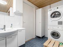 Tila kodin pyykkihuollolle.