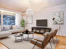 Olohuone, josta löytyy ilmalämpöpumppu viilentämään huonetilaa kuumana kesäpäivänä.