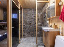 Saunan seinä käsin ladottua kiveä