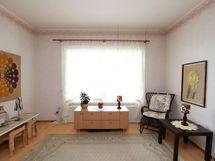 Vasemman puoleisen huoneiston olohuone